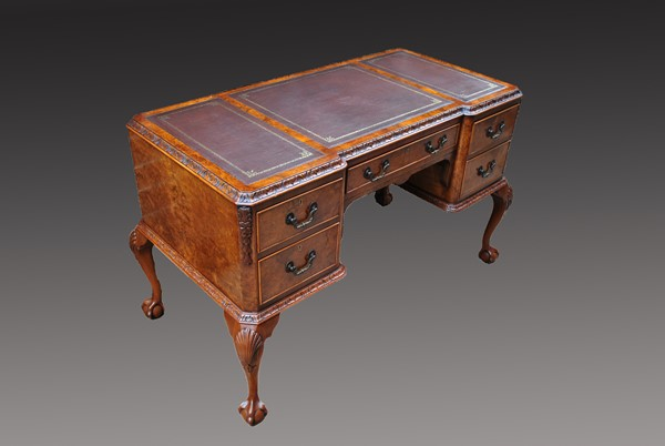 Edwardian walnut writing table after restoration